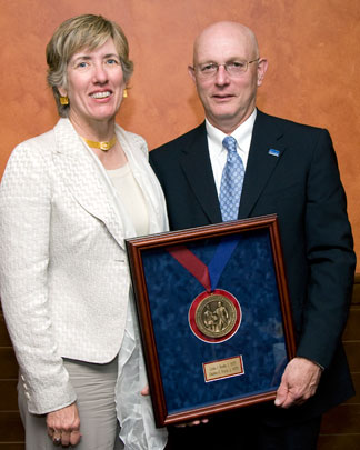 Lydia Beebe and Chuck Doyle, pictured in 2008 with their James Woods Green Medallion.