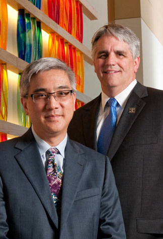 Left, Terance T. Tsue, M.D., physician-in-chief of The University of Kansas Cancer Center, and Roy A. Jensen, M.D., cancer center director