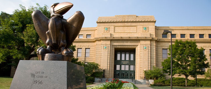 Bronze Jayhawk in front of Strong Hall
