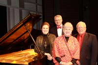 Pictured with Lied Center's new  Steinway piano are, from left,  Barbara Nordling, Hurst Coffman,  and Gunda and Dave Hiebert.